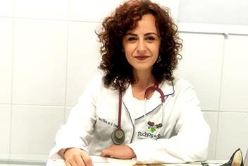 Dra. Flávia Oliveira